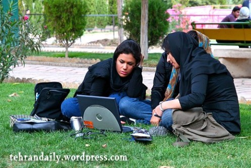Girl Students Working by Laptop