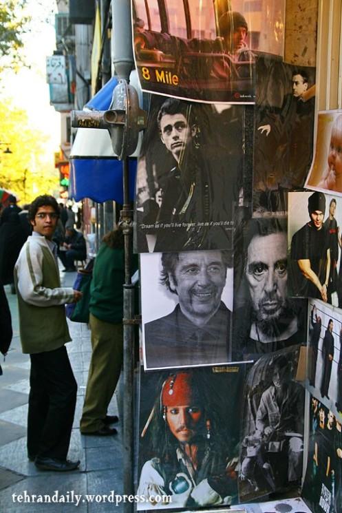 Selling Posters in Sidewalk